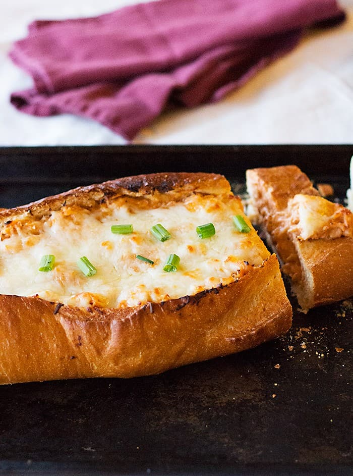 This Buffalo Chicken French Bread is the ultimate game day or any fun day food! It's beyond delicious!