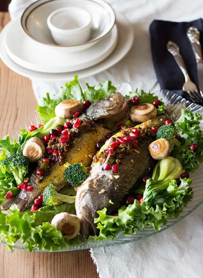 Serve Persian style stuffed fish with Sabzi Polo, rice or potatoes.
