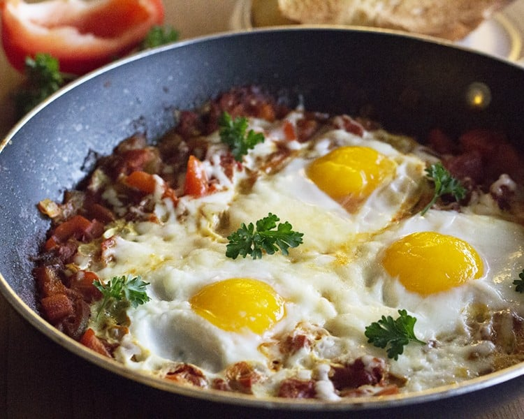 This Cheesy Shakshuka is bursting with flavor! A few ingredients and tons of flavor!