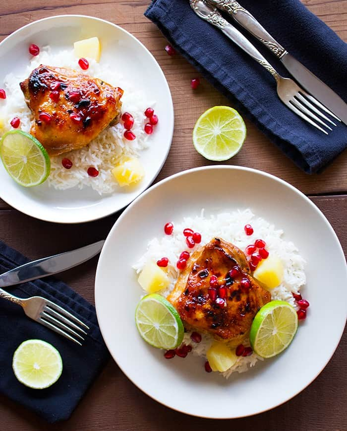 baked pineapple chicken thighs with white rice.