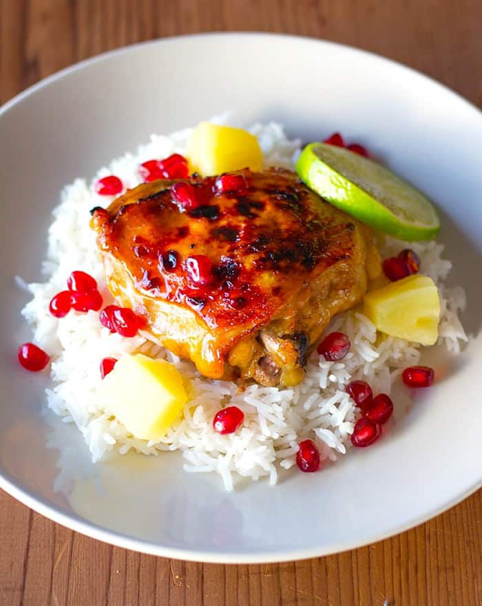 Sweet and savory chicken thighs with pomegranate arils.