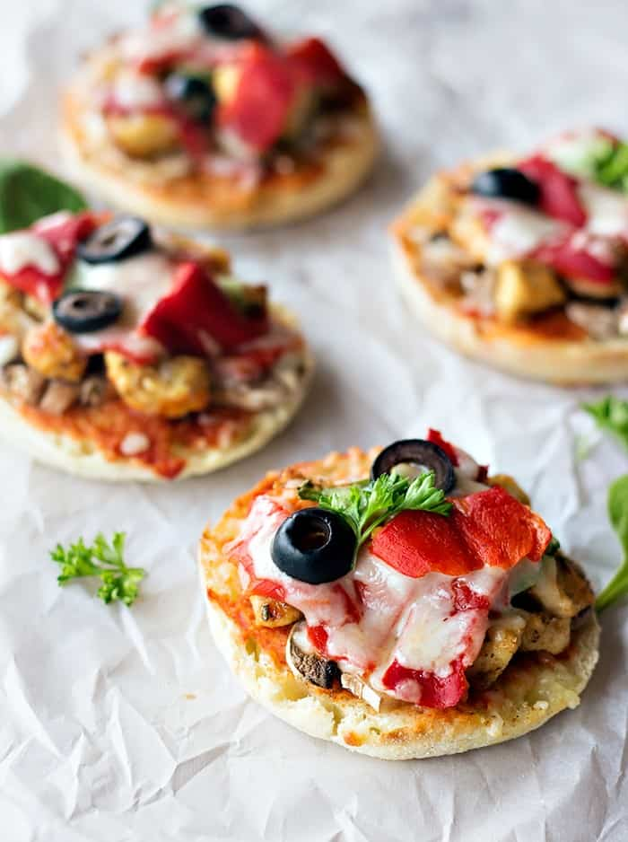 Easy English muffin mini pizza topped with parsley.