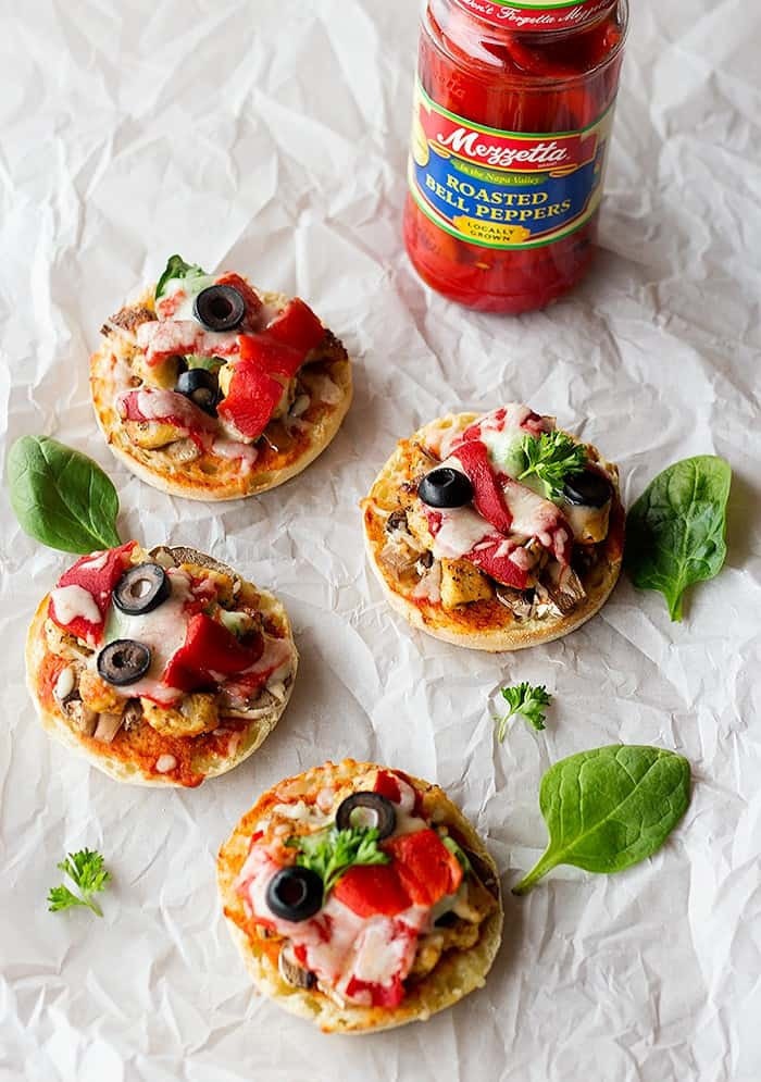 English muffin pizza with bbq chicken and roasted peppers topped with olives.