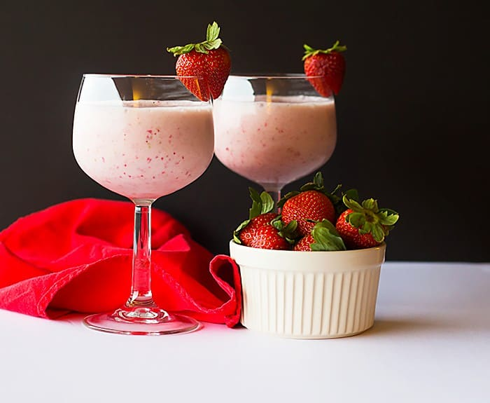 You see how to make a strawberry milkshake healthy with using bananas instead of ice cream.