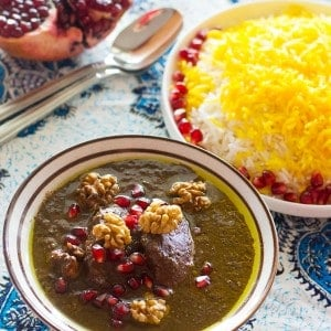 Dive in to Persian deliciousness! Khoresht Fesenjan is a wonderful combination of pomegranate and walnut served with Persian style rice and saffron.