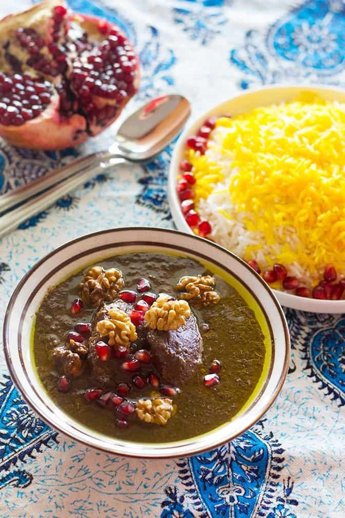 Khoresh Fesenjan, also called fesenjoon, served with saffron rice.