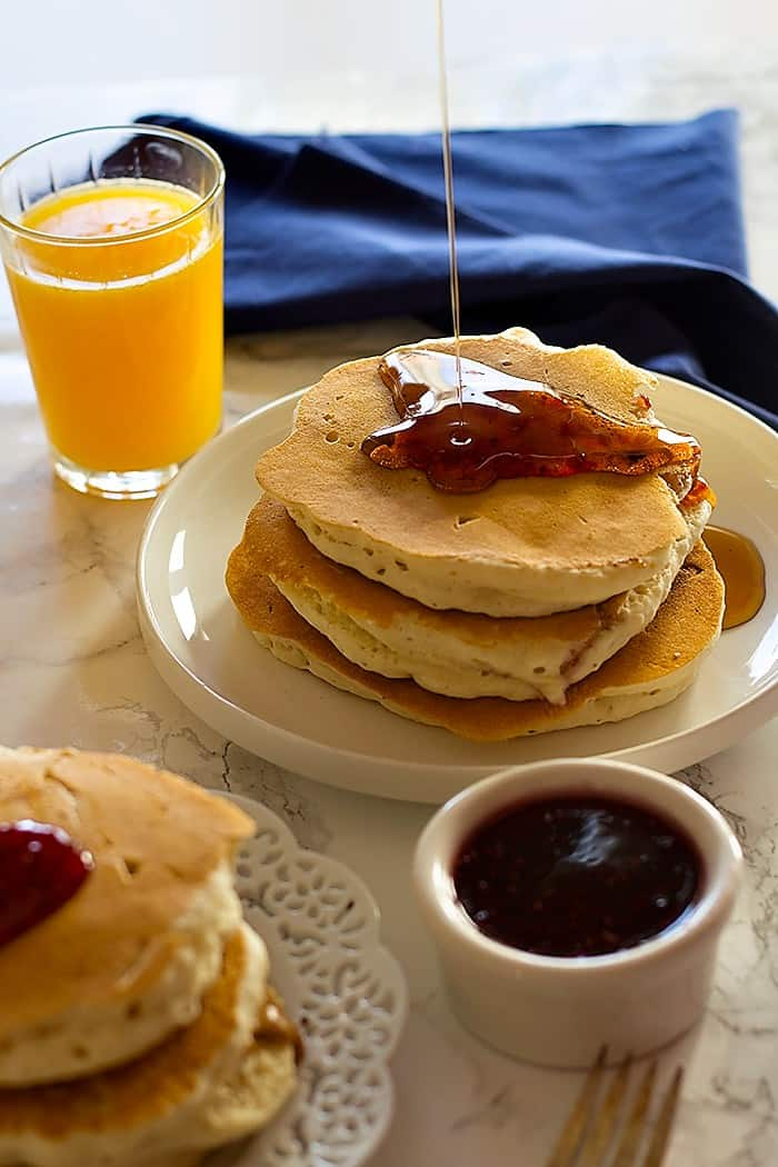 Peanut Butter and Jelly Stuffed Pancakes are two favorite breakfast foods in one! They are fluffy with a center of creamy peanut butter and jelly. It can't get any better!