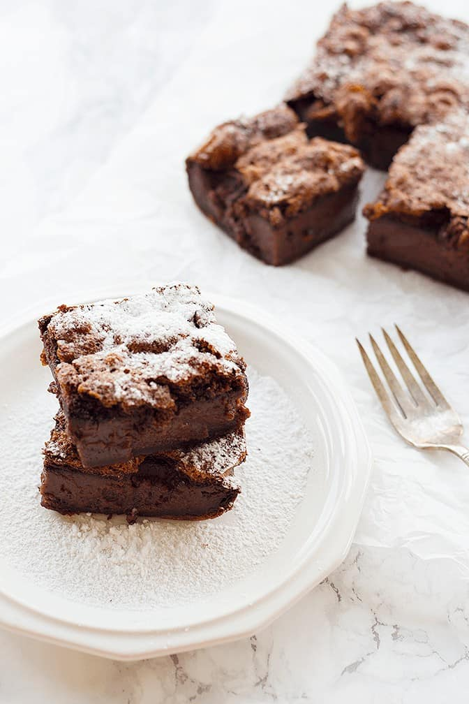 Chocolate Magic Cake - Let the cake cool completely, slice into 9 squares and dust with powdered sugar.