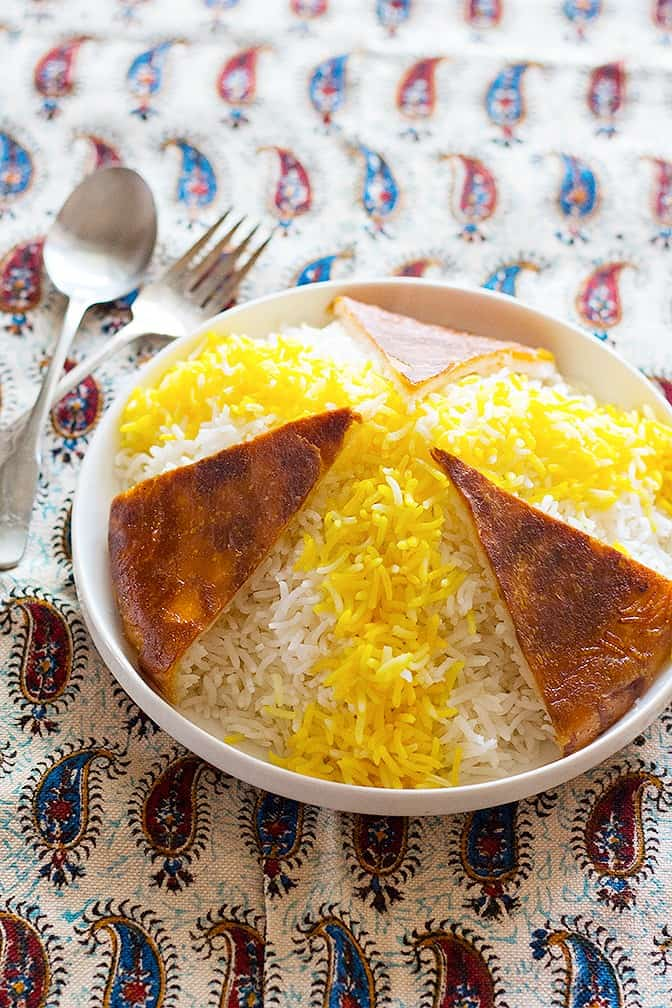 Persian Rice and Tahdig. Infuse some of the rice with brewed saffron and spread over the white Basmati Rice.