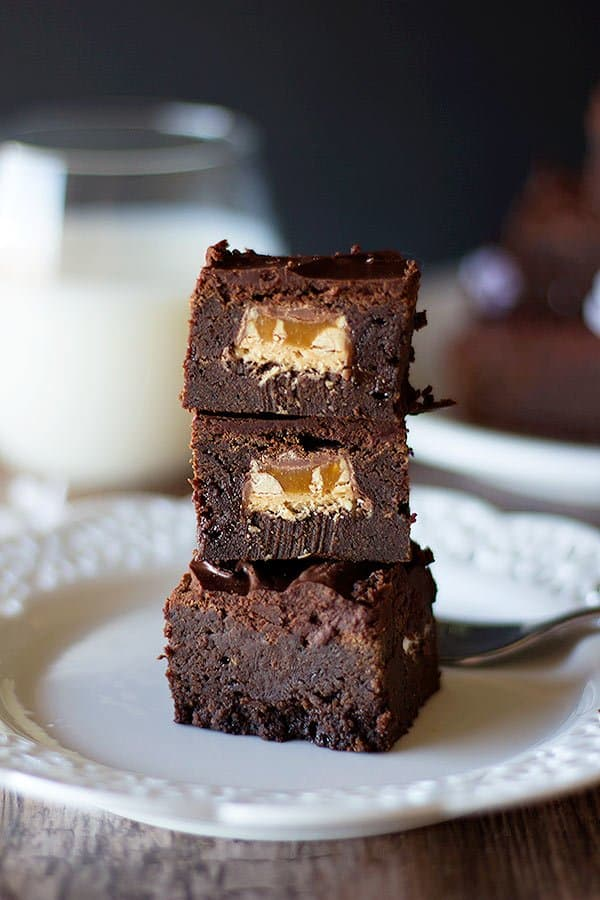 These stuffed brownies have a piece of snickers inside!