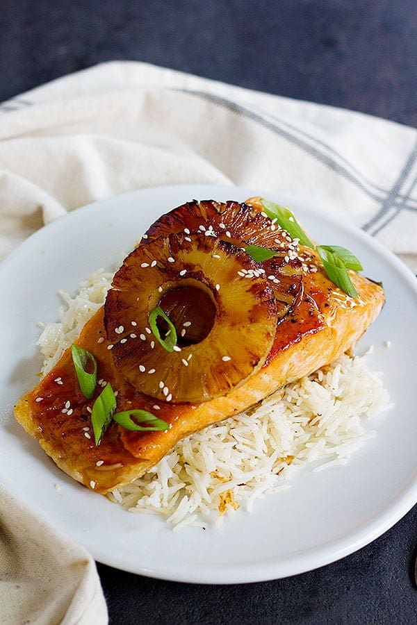 Teriyaki pineapple salmon give you a delicious twist usual seafood recipe. Enjoy fresh pan-seared salmon smothered in delicious sweet and tangy sauce topped with caramelized pineapple!