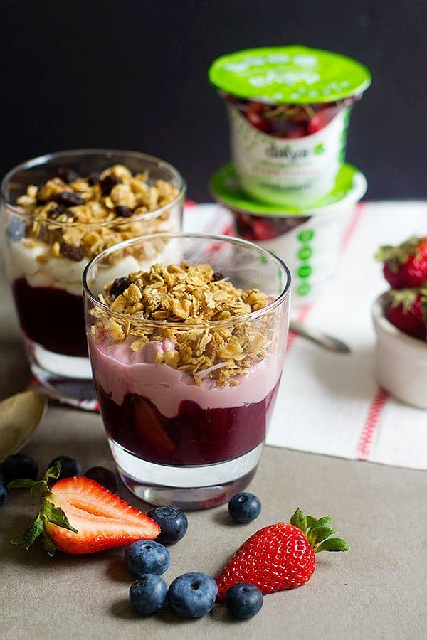 Start your day happily with a delicious Mixed Berry Granola Parfait. Delicious layers of mixed berries, yogurt alternative, and granola = perfection in every spoonful.