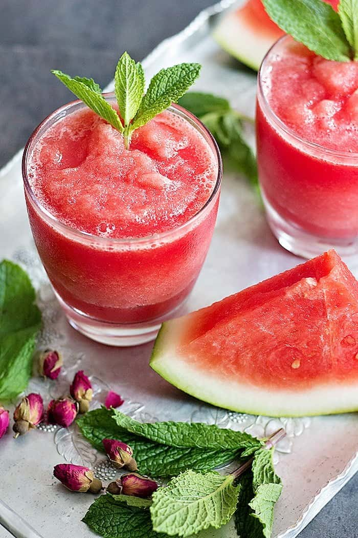 Watermelon Rose Slushie is great for summer. Juicy and sweet watermelon blended with rose water makes this a delicious natural drink for hot days!