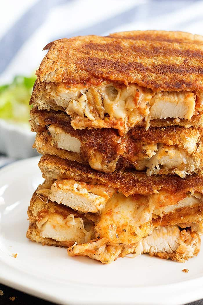 Grilled chicken cheese sandwich with chicken and cheese and marinara sauce