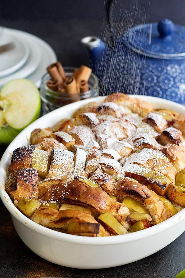Sprinkle powdered sugar on finished French toast casserole.
