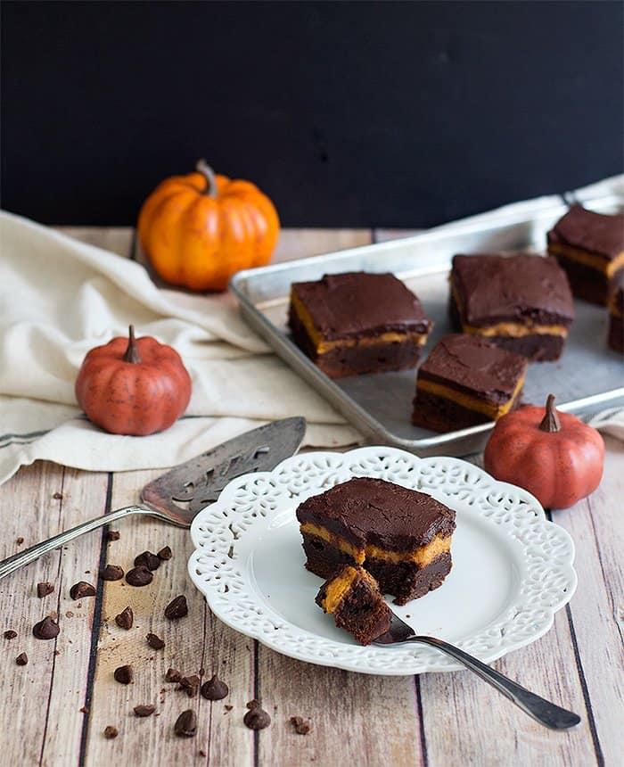 Pumpkin brownies with a pumpkin pie layer are the best autumn dessert!