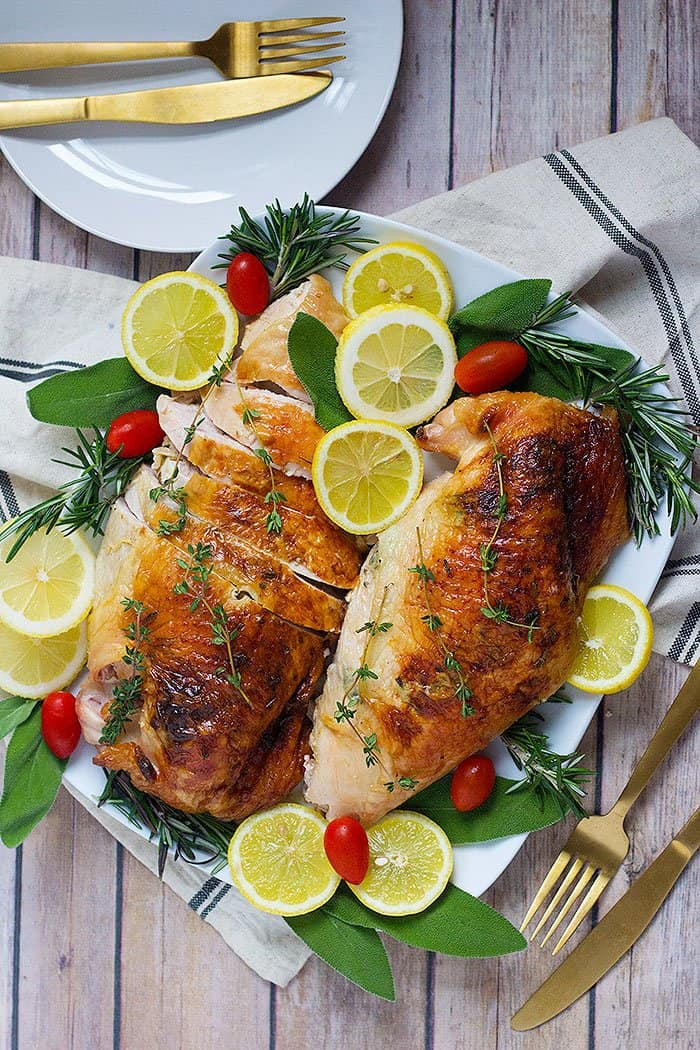 This herb roasted turkey breast recipe is perfect for a family dinner or your Thanksgiving table! The combination of herbs, butter and lemon results in a delicious and moist turkey breast!