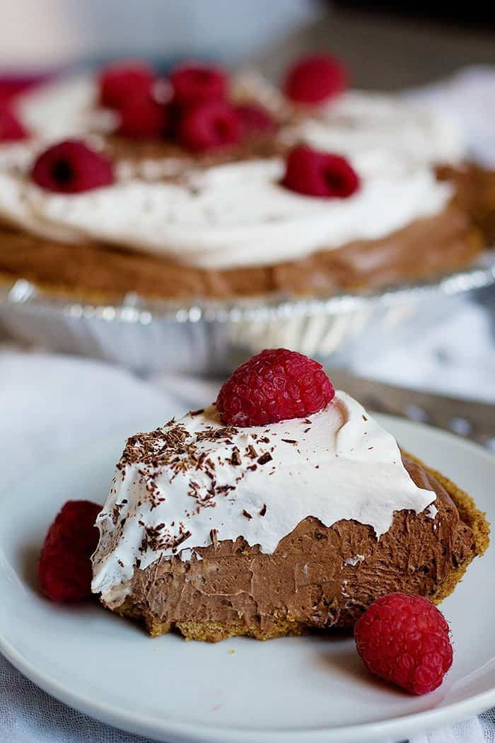 A slice of Homemade Chocolate Cream Pie with whipped cream.