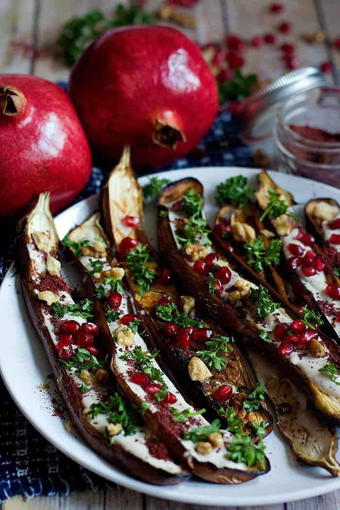 Oven Roasted Middle Eastern Eggplant with sumac, yogurt tahini sauce, pomegranates and walnuts.