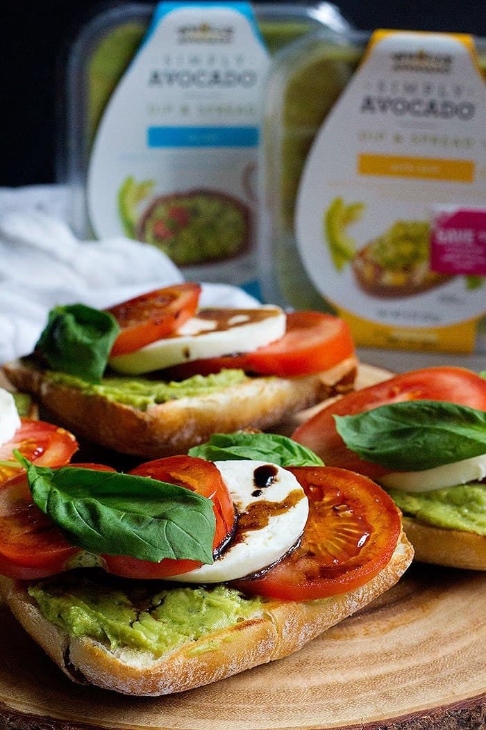Caprese Sandwich Recipe Ciabatta bread topped with avocado, mozzarella and tomatoes.