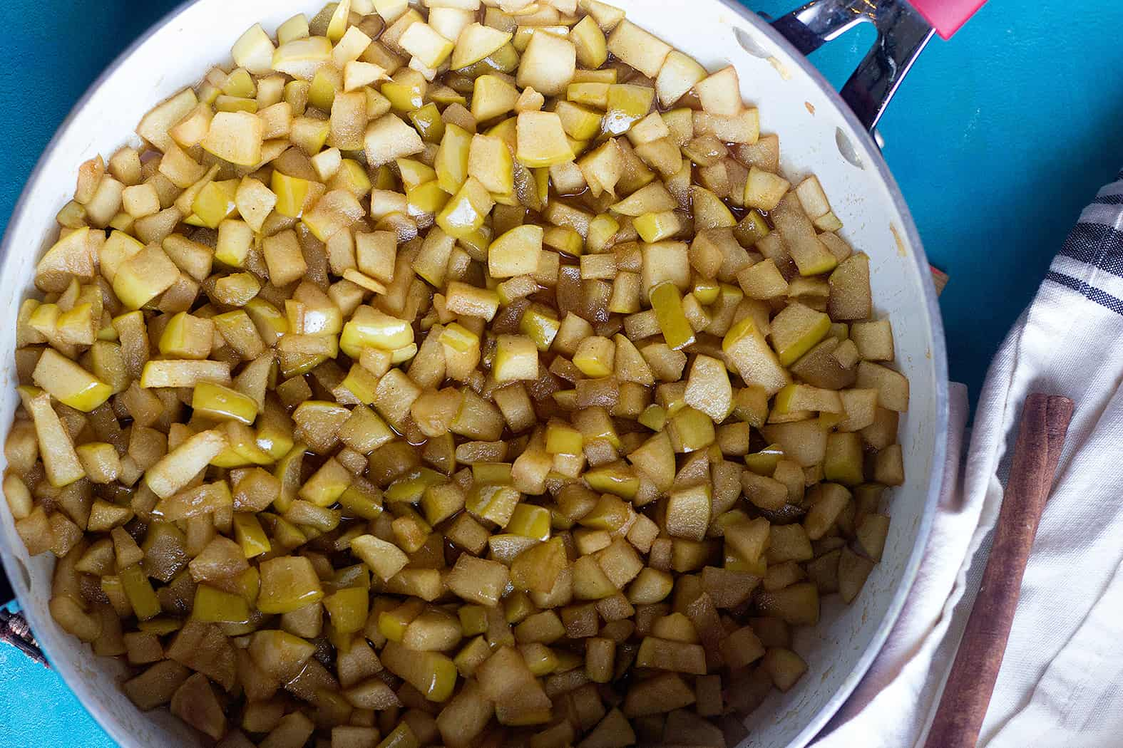 Cook apples butter cinnamon and brown sugar in a large pan until soft.