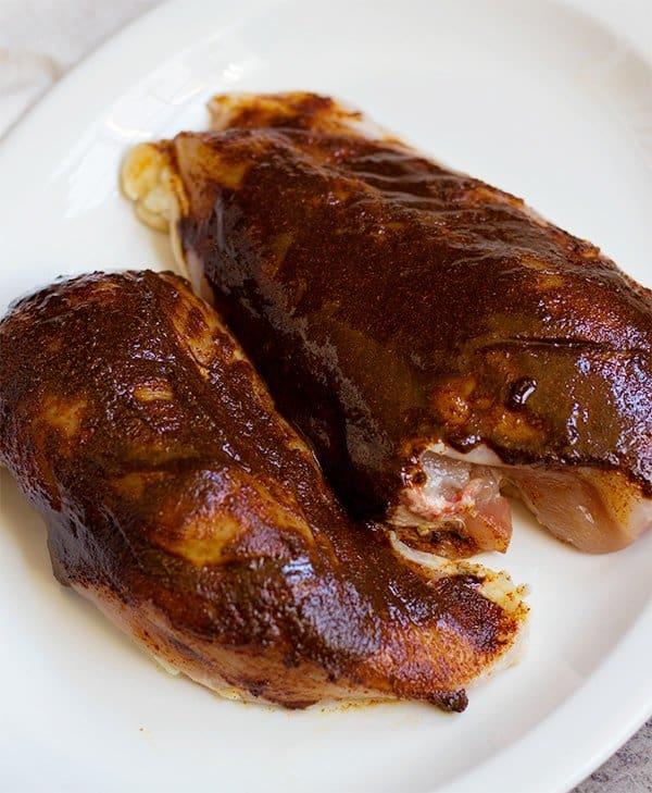 Rub the Moroccan chicken marinade paste all over the chicken breast.