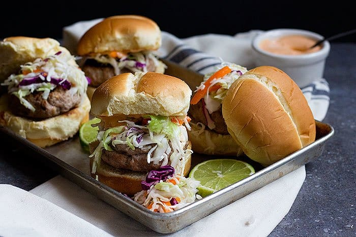 Thai Turkey Burgers are a lighter version of an all time favorite dish. Juicy turkey patties flavored with Thai spices and paired with a delicious Thai coleslaw make the perfect meal!