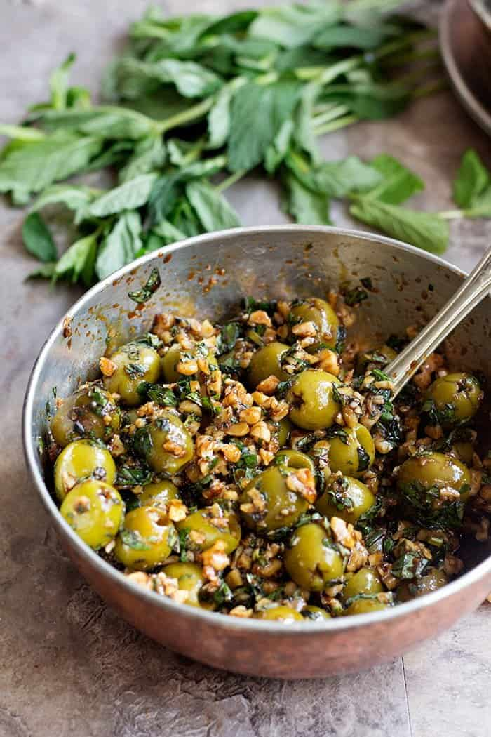 Marinated olives made Persian style with walnuts and pomegranate molasses.