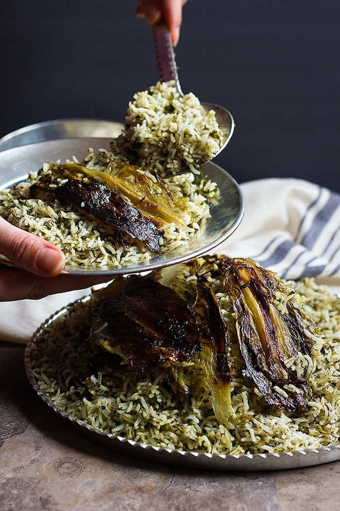 Sabzi Polo is a delicious Persian herb rice that's served with fish for Persian new year.