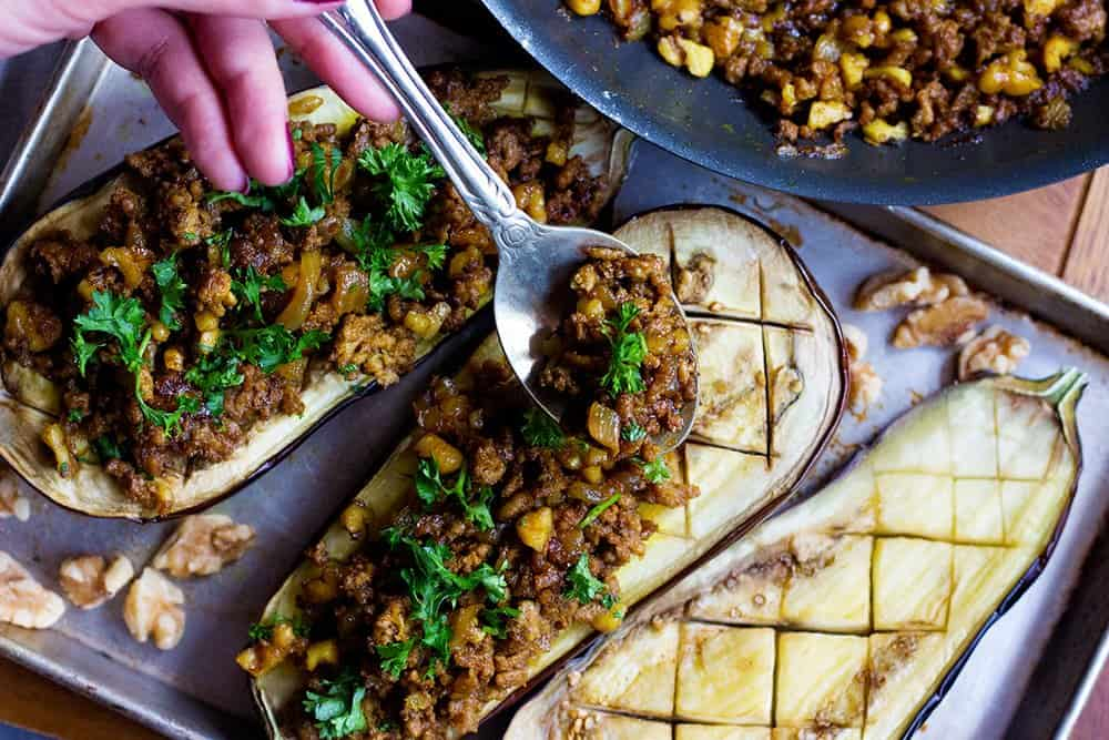 Make the filling with sauteed lamb and walnuts for stuffed eggplant,
