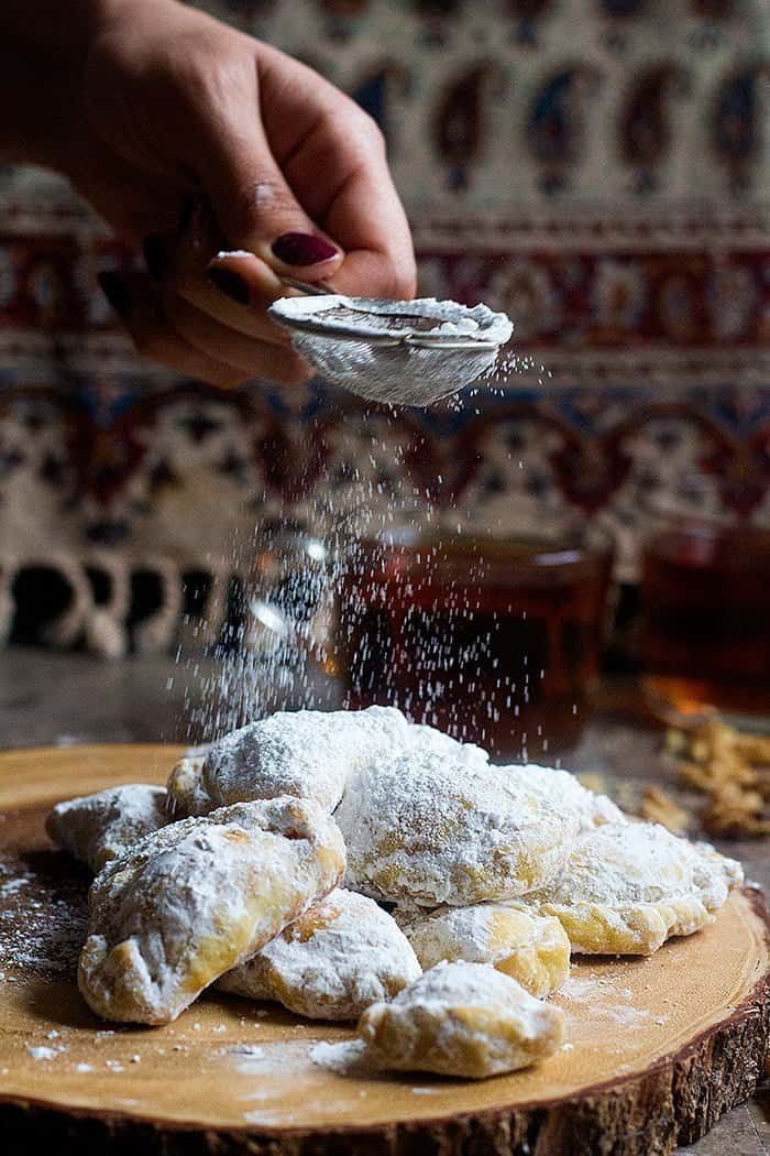 Sprinkle powdered sugar on the Persian sweets and serve with some tea.