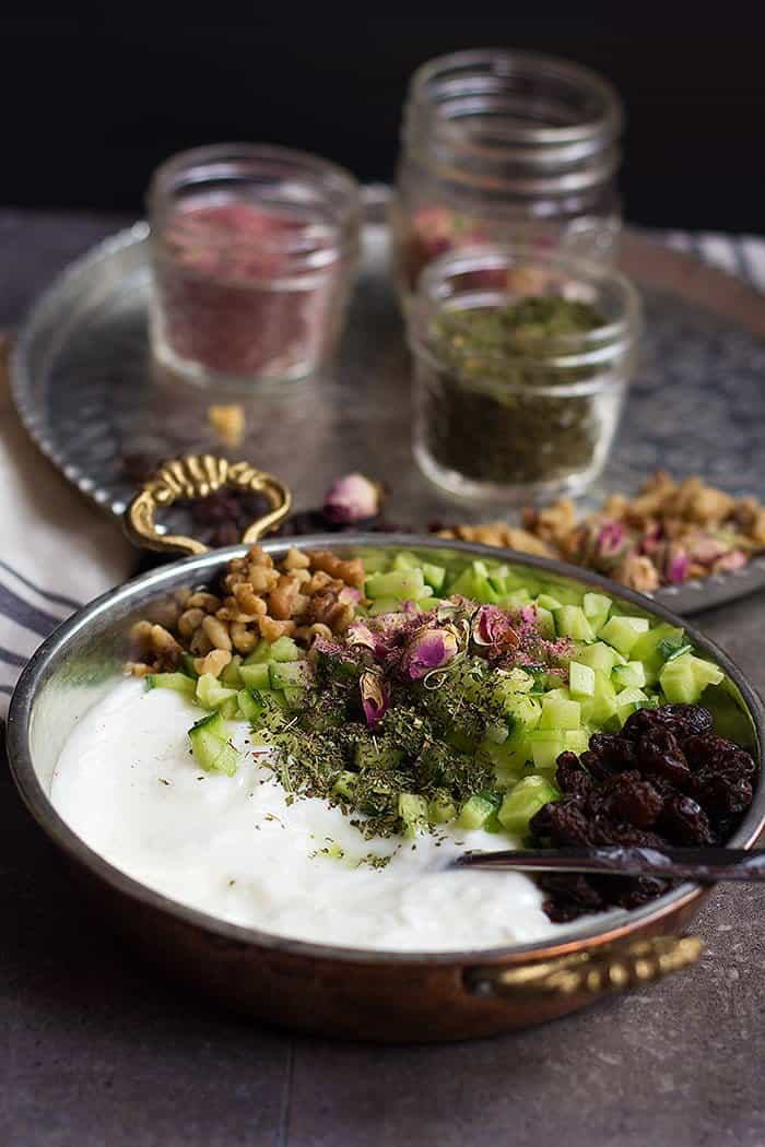 This cucumber dip is flavored with raisins and walnuts.