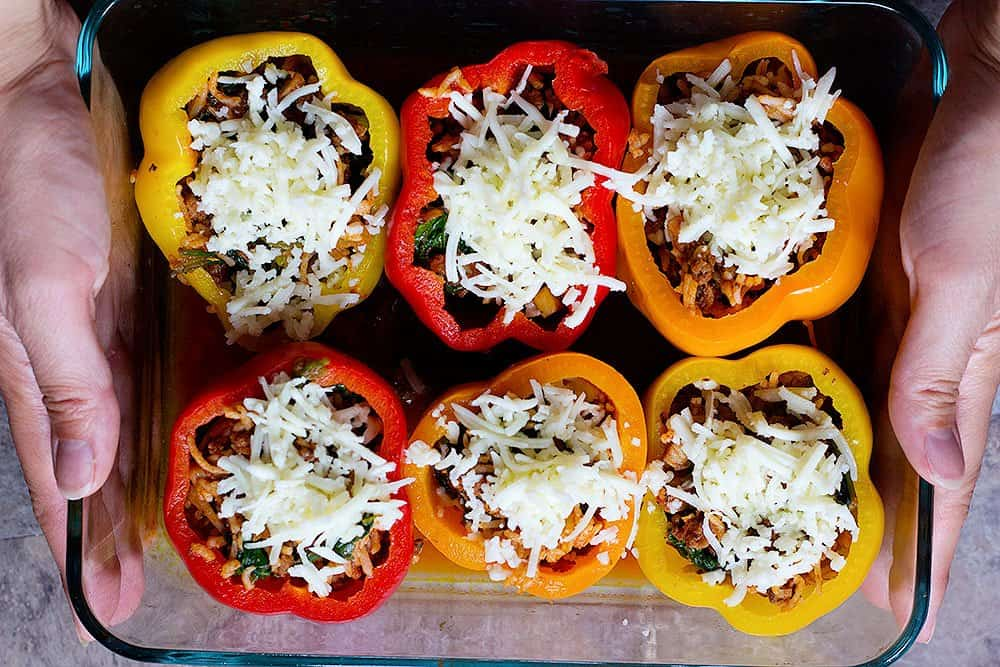 stuffed bell peppers with rice topped with shredded mozzarella cheese and bake in the oven.