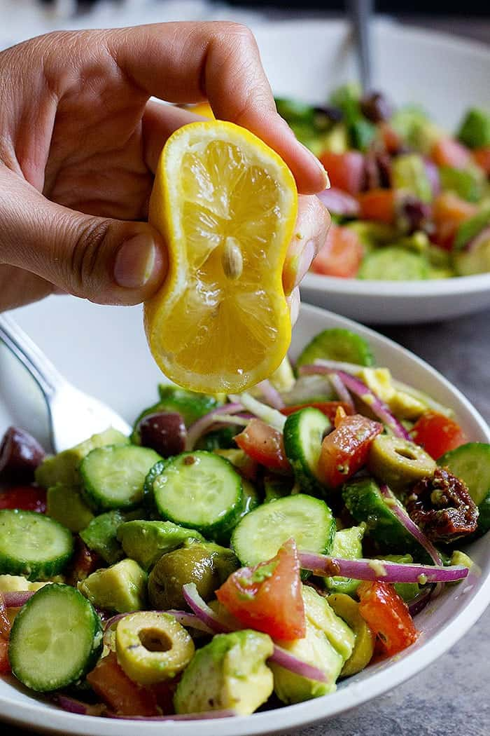 This cucumber tomato avocado salad is perfect for any day of the week. This easy and tasty salad comes together in no time and is full of flavor thanks to sun dried tomatoes and olives.