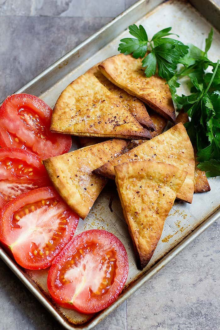 Make crispy and delicious pita chips at your home with just a few ingredients in less than twenty minutes.