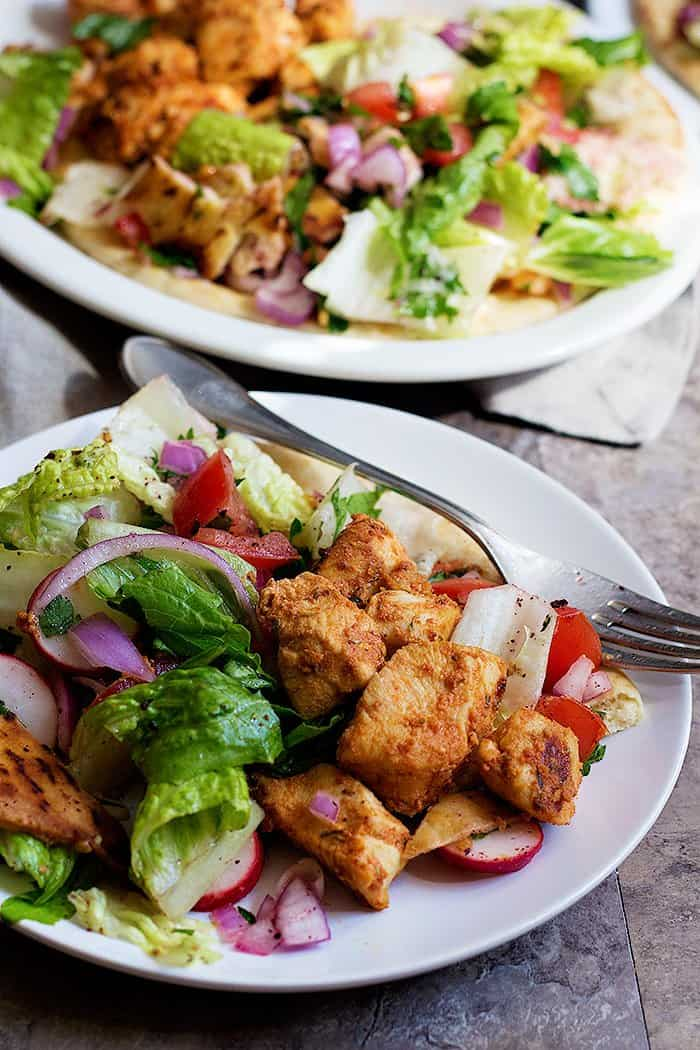 Serve chicken shish with salad and pita bread.
