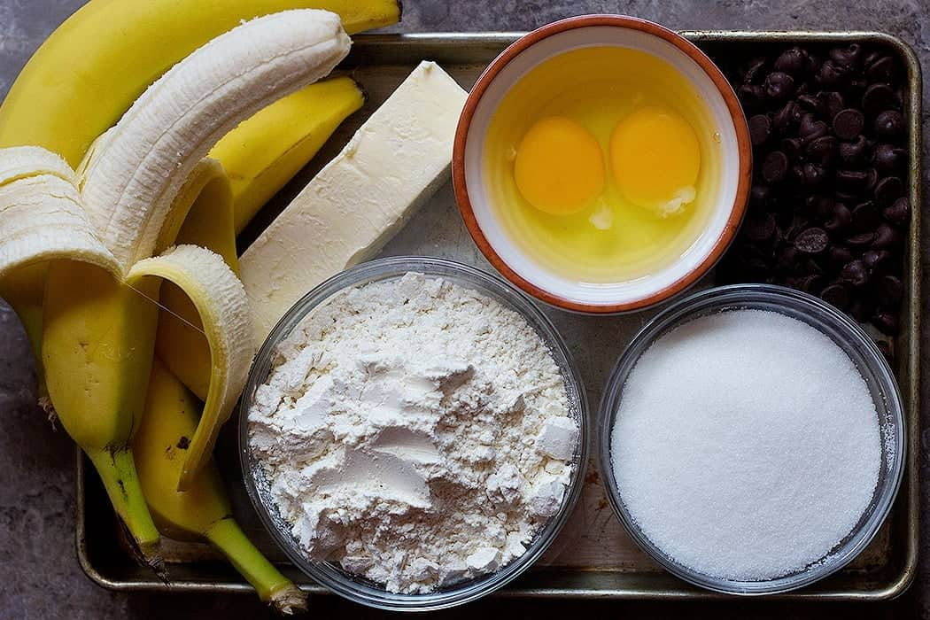 To make choc chip banana bread you need bananas, flour, sugar, eggs, and butter.
