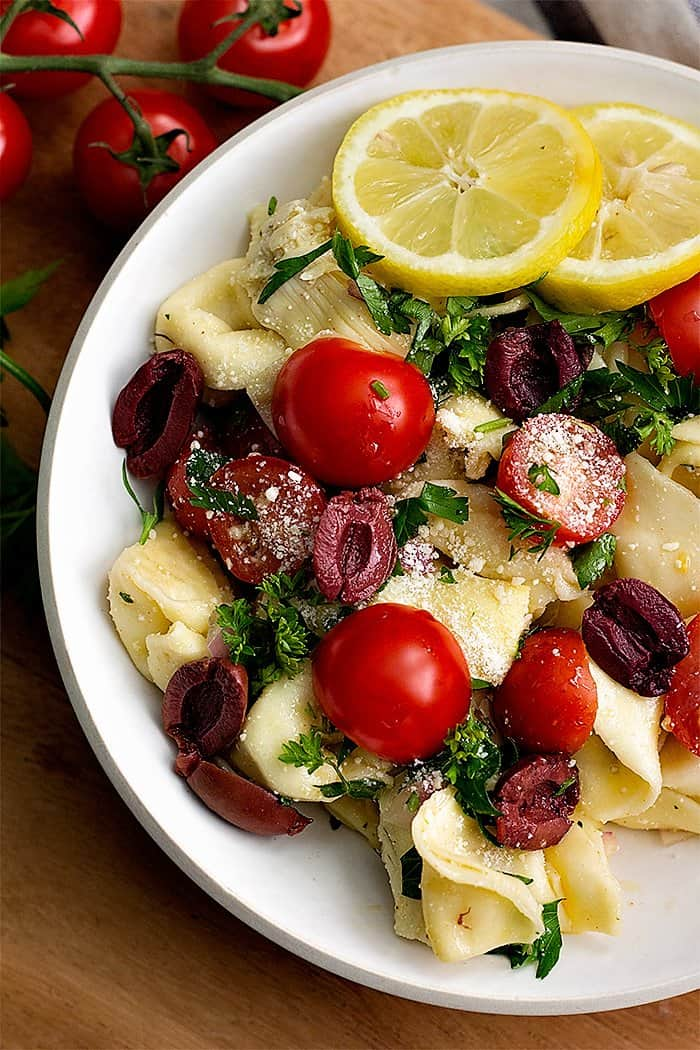 This tortellini summer pasta salad with a Mediterranean twist is the perfect side dish for any potluck. Make this easy tortellini salad with just a few ingredients.