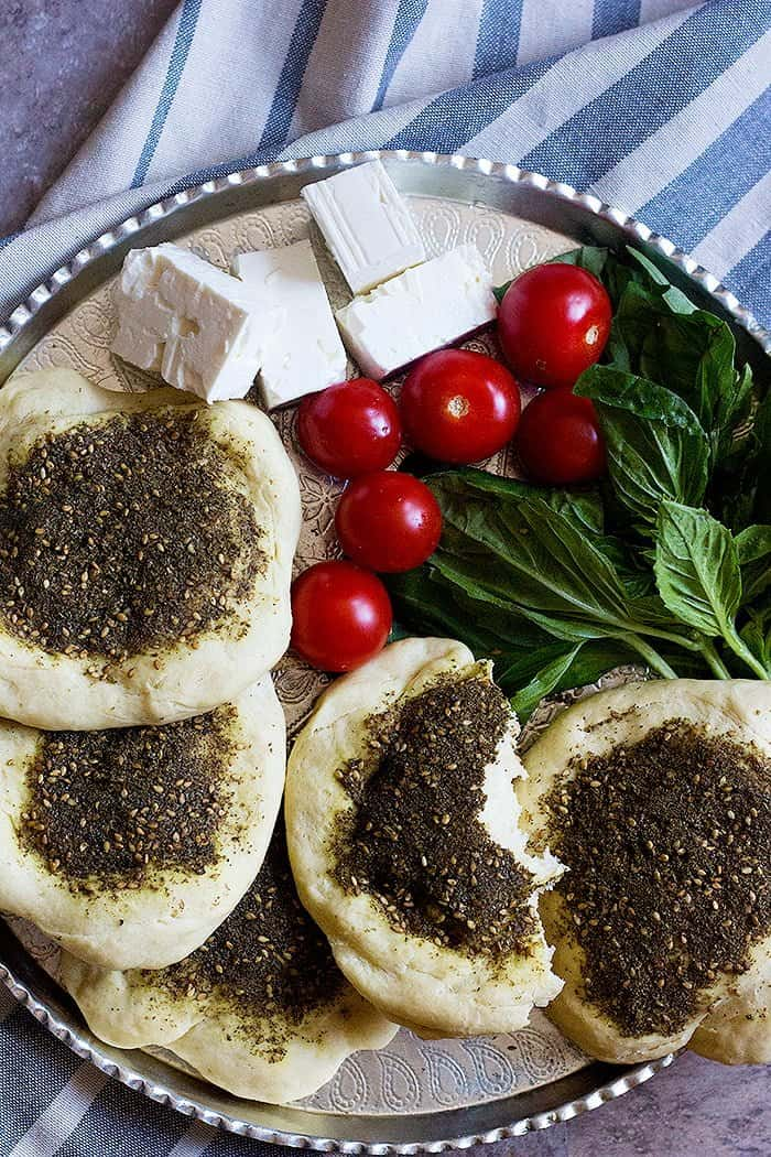 Manakish zaatar is a delicious Middle Eastern flatbread topped with zaatar. Learn how to make this delicious zaatar bread from scratch with just a few ingredients.