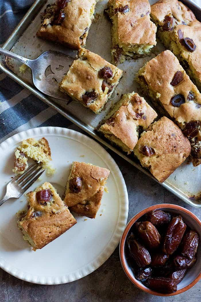 Slices of date cake on a tray. This is an easy cake that's lightly sweetened.