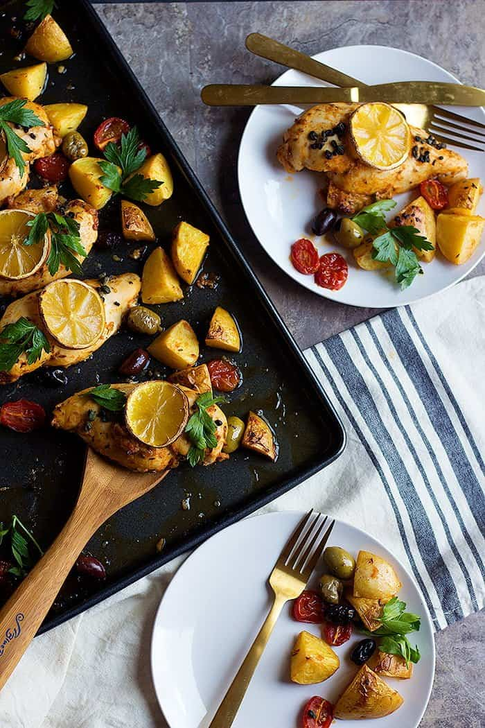 Mediterranean sheet pan chicken and potatoes with capers, olives and parsley