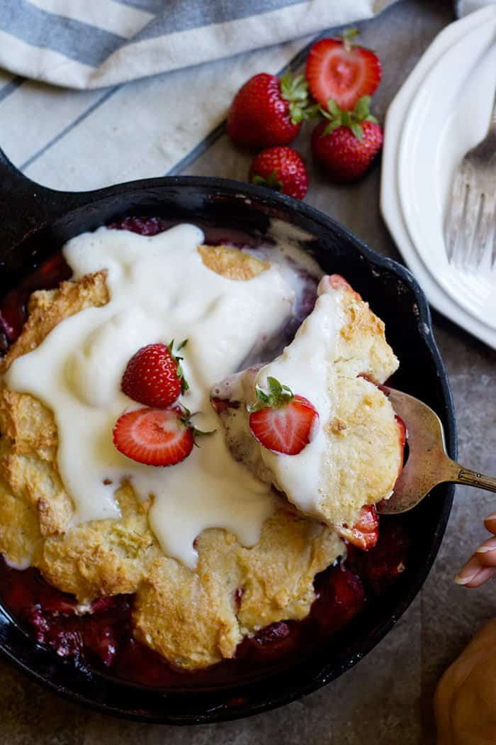 Strawberry cobbler is the ultimate summer dessert especially when served with ice cream. This cobbler recipe is easy to make and is perfect for dessert.