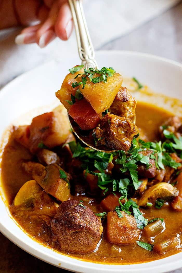 serve lamb and potato stew warm with parsley.