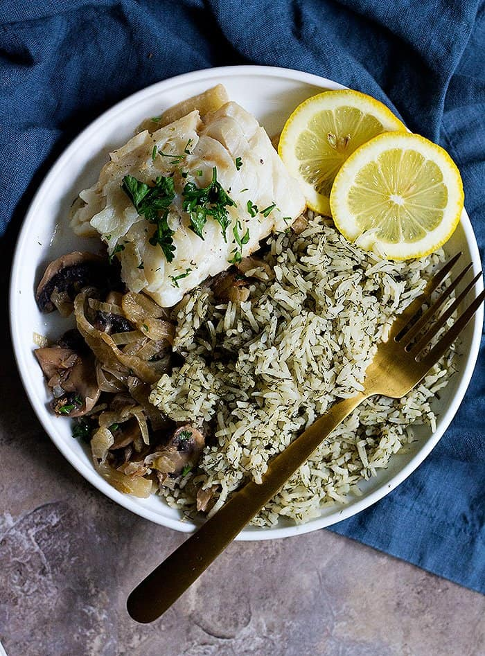 Serve pan seared cod fillets with dill rice, mushrooms and fennel.