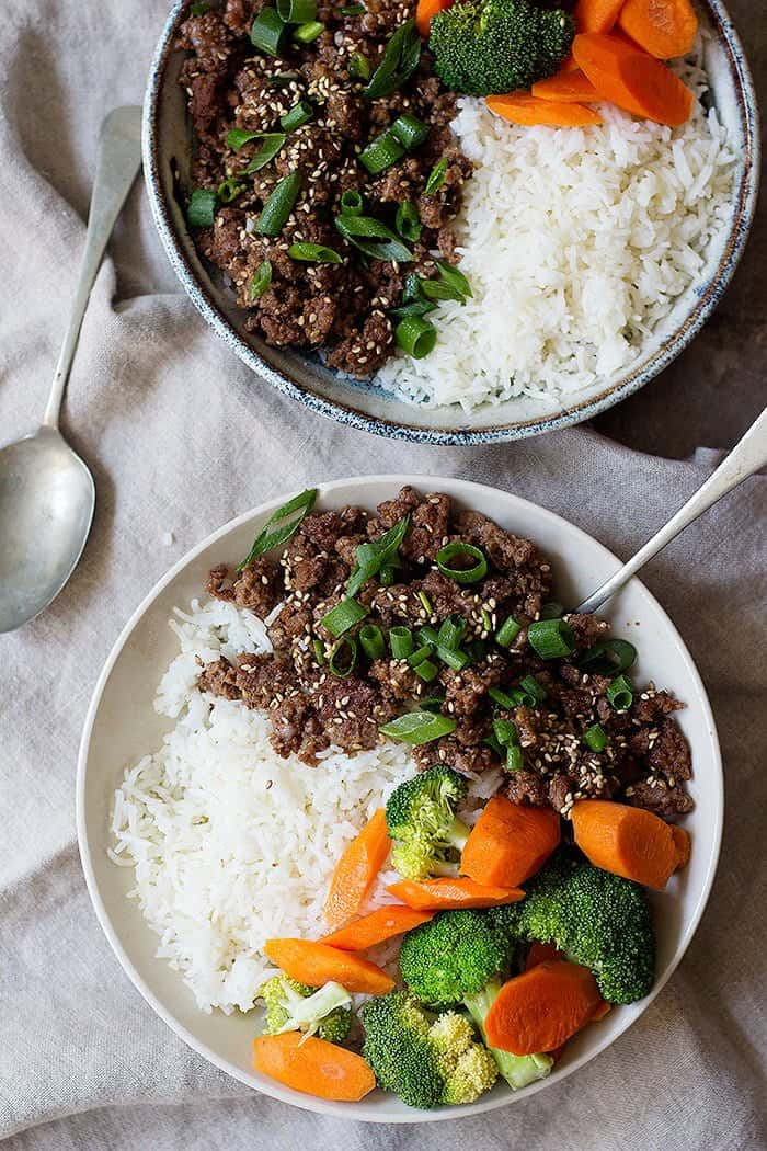 Korean beef bowl is the ultimate weeknight dinner. Flavorful ground beef and rice cooked in a flavorful sauce make an easy meal in only twenty minutes!