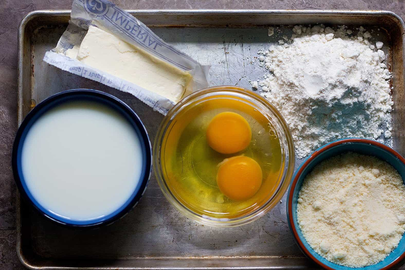 To make Bechamel sauce you need butter, flour, milk, eggs and parmesan cheese.