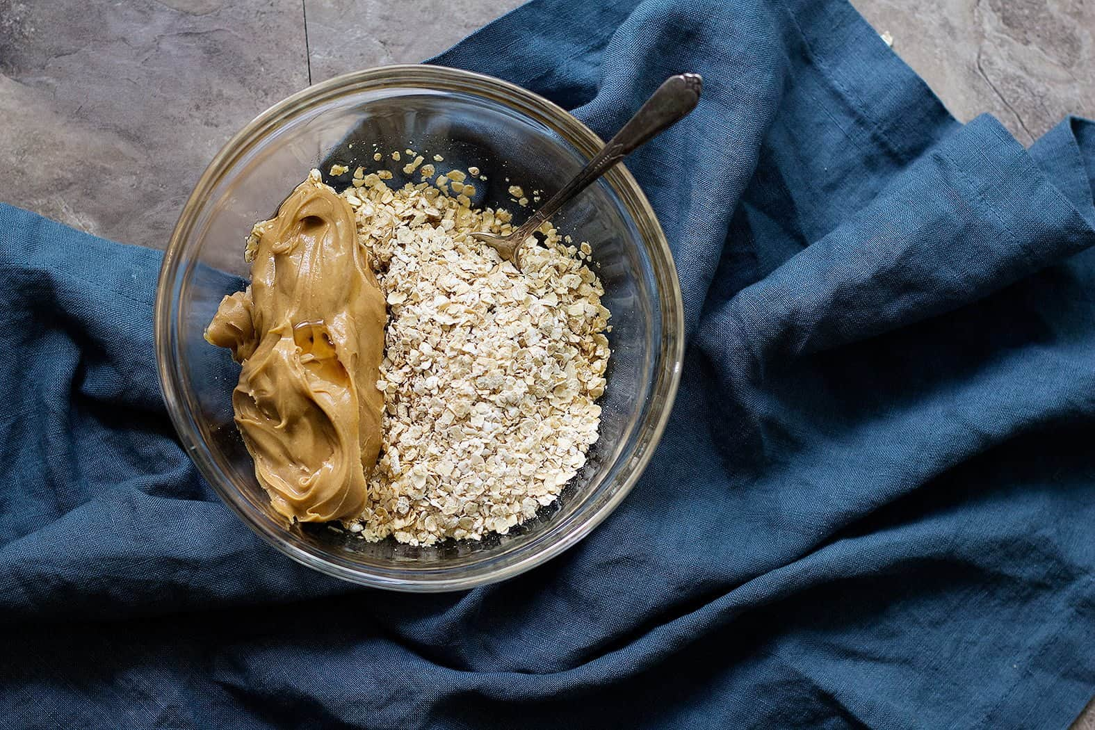 Mix peanut butter and oatmeal in a bowl. Add maple syrup and mix well.