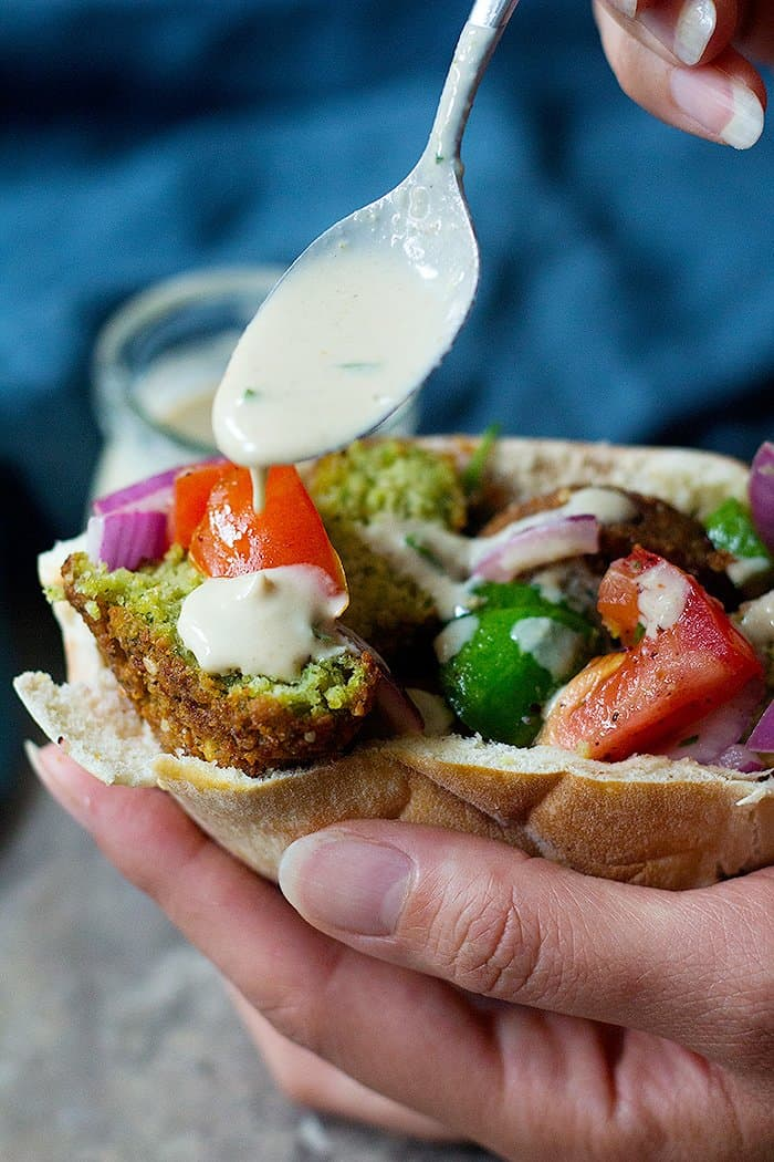 Homemade tahini sauce can be used as a condiment for falafel sandwich.
