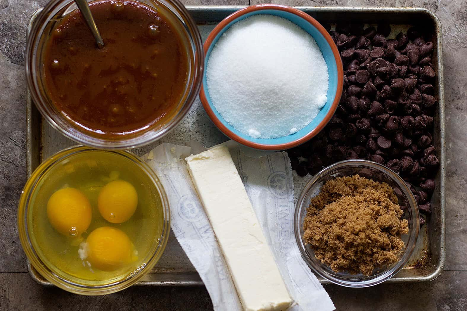 To make homemade brownies with caramel you need butter, chocolate, sugars, eggs, flour and caramel sauce.