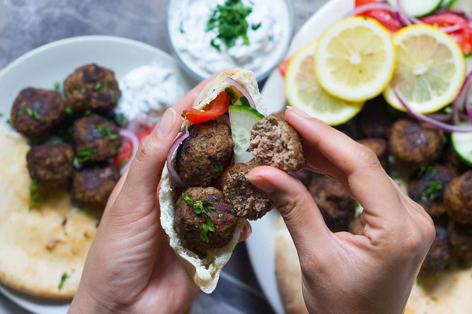 You can stuff a pita bread with Greek meatballs and vegetables.